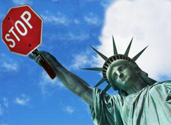 Illegal Immiigration Statue of Liberty with Stop Sign